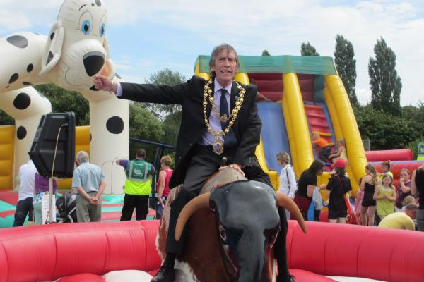 YEE HAA: Mayor of Kidderminster Mike Price taking a ride on the rodeo bull.