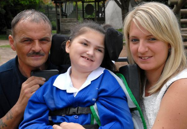 FUNDRAISING EFFORTS: From left, Peter, Leah and Michelle Perry. 251444M