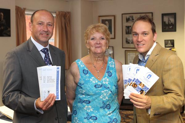 SUPPORT: Ruth Gregory with Brian Colley, director of Talbot Solicitors, left, and councillor Marcus Hart at the launch of the Severn-Stour Grandparents' Support Group.