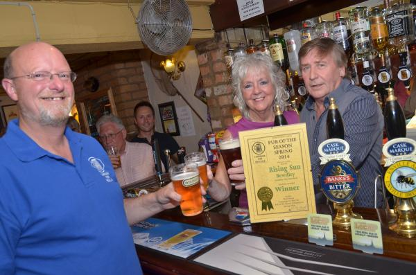 AWARD WINNERS: Geoff and Kaye Mansfield celebrate their award with Nick Yarwood, chairman of Wyre Forest CAMRA. Picture: COLIN HILL