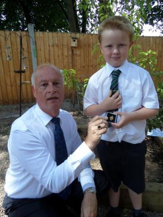GOLDEN BOY: William Wallace, 7, receiving his Blue Peter badge from The Knoll School headteacher, Nigel Humphries.