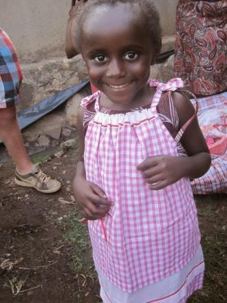 CRAFT WORKSHOP: A girl in Africa wearing a pillowcase dress.