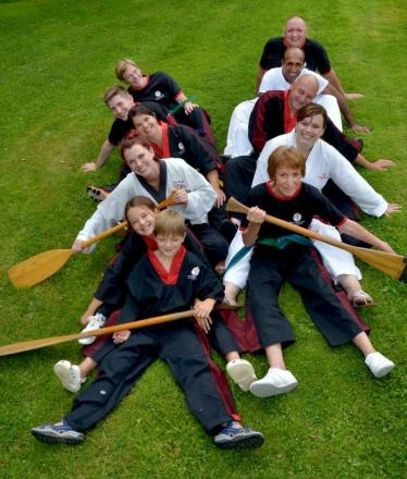DRAGON BOATING: The West Midlands Taekwondo crew prepares for the water sports festival. Picture: COLIN HILL