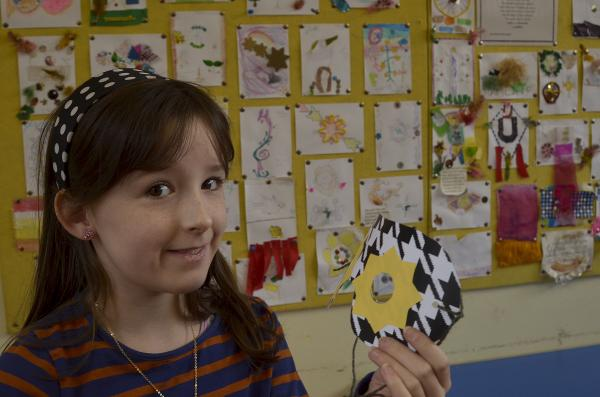 CHILDREN'S CRAFTS: Amy Shepherd of Kidderminster making a jester's mask.