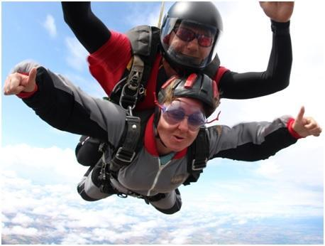 SKYFALL: Jean Young, bottom, with her skydiving instructor, raising money for Mentor Link.