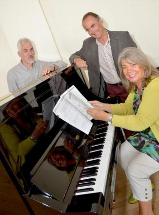 NEW INSTRUMENT: From left, Peter Barnett, Richard Perrin, trustee of the Helen Mackaness Charitable Trust, and Jenny Paddock, director of St George's Hall. Picture: COLIN HILL