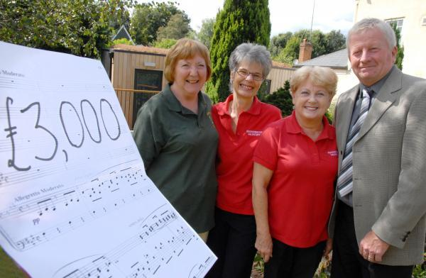 FUNDRAISING SUCCESS: From left, Denise Carson of Kidderminster Foodbank, Sue Strong  and Doreen Harkins of Kidderminster Valentines and Kevin Hateley of Kemp Hospice. 341450M