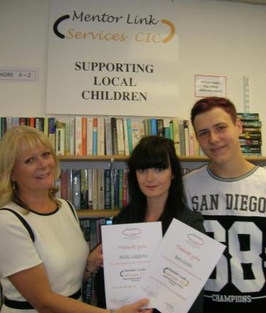 THANKS: Andrea Maddocks presenting two of the student volunteers, Alice Liggins and Ben Owen, with certificates.