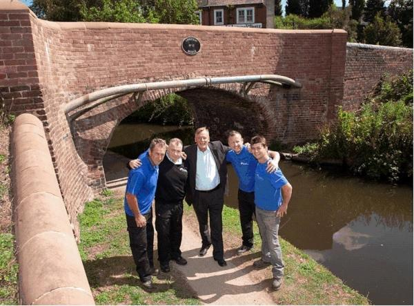 BRIDGE RESTORED: Stephen Rose, centre with, from left, John Dunkley, Keith Bradfield, Mike Latham and Neil Paskin of the Canal and River Trust.