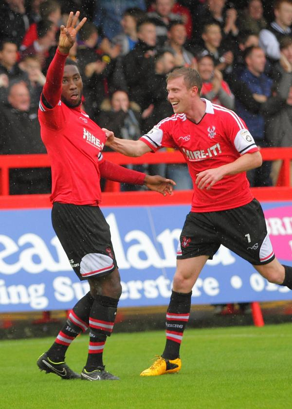 Highs and lows: Chey Dunkley celebrates his goal with Jack Byrne before his sending off against Chester. Picture: ADRIAN HOSKINS