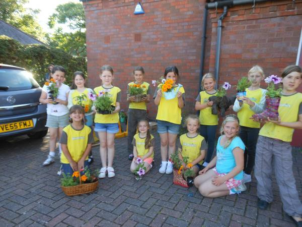 CENTENARY CELEBRATIONS: Stourport brownies go potty about recycling to make gifts.