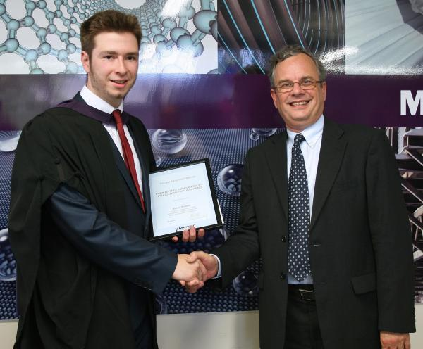 TOP OF THE CLASS: William Rowlands receiving the award best undergraduate research project in ceramics from Dr Chris Hampson, of Morgan Advanced Materials.