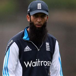 Moeen Ali, pictured, is standing by Alastair Cook