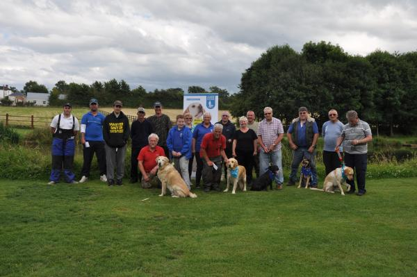 REELING IN THE FUNDS: Marie Court with other Guide Dog volunteers and fishing contestants.