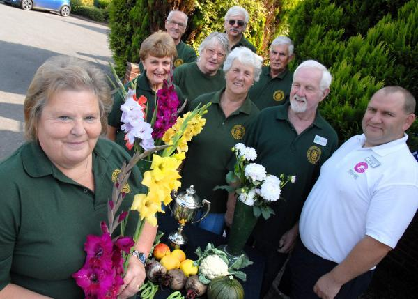 SIXTIETH YEAR: Kidderminster Horticultural Society members Louise Aston, Jean Hughes, Trevor Jones, Christina Bytheway, Brian Bytheway, Edna Jones, Vic Morris, Colin Costin, and Alastair Day, of Mercure Hotels. 371443M