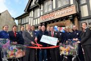 OFFICIALLY OPEN: Mayor of Bewdley, Councillor Derek Killingworth, opening the new Bewdley Tesco store with chairman of trustees for Bewdley Youth Cafe, David Beard, store manager Leighton Pickett, and staff.
