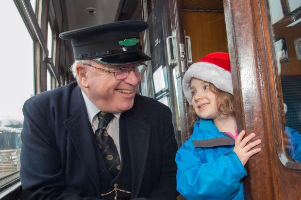 CHRISTMAS CARRIAGE: Evelyn Sanders, then aged 4, enjoying a trip on Severn Valley railway last year.