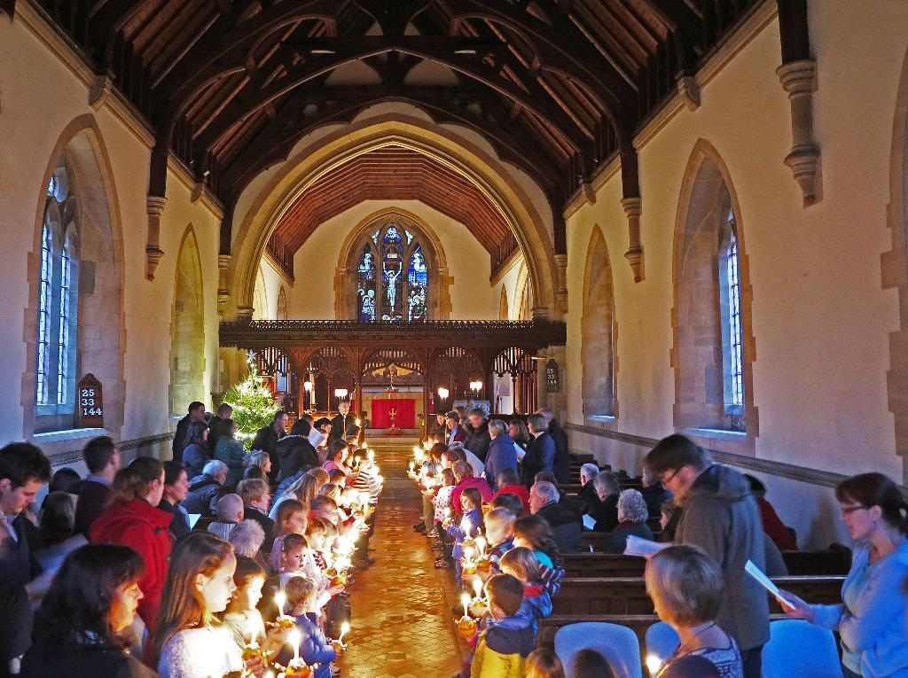 BEST BEHAVIOUR: Children celebrate Christingle at Crowle, near Worcester. Photograph by Bob Brierley
