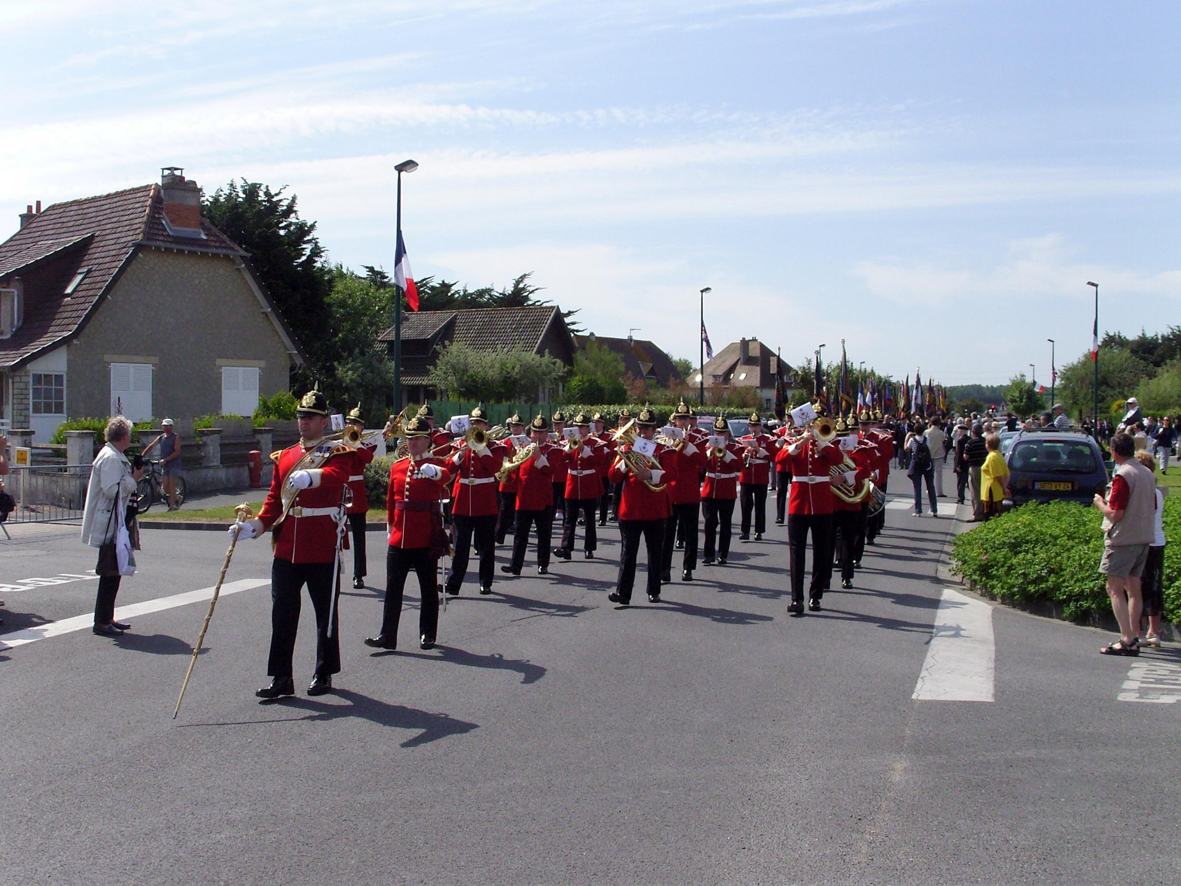 PARADE: Soldiers parade through Arromanches, Normandy.