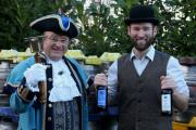 AWARD WINNERS: Jim Davis, founder of Hobsons, celebrate the Old Henry and Town Crier bottles picking up gold and bronze medals at the CAMRA West Midlands Beer of the Year competition with Tim Sant.