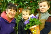 L-r - Nicky Bright from Webbs with Henry and Spencer Bryan making a gift for Mothers' Day