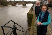 Dr Richard Taylor and Pat Jones by the new railings which run down the steps into the Severn. 151003L