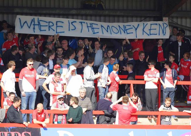 Harriers fans hold up a banner during Monday's loss to Bristol Rovers. Picture: ADRIAN HOSKINS