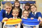 Bayton CE Primary School teacher Vicky May and Gemma Timmis from Acorns Children's Hospice, with pupils Max Barnsley, nine, Daniel May, five, Lara Cigsar, four, and Lily Denver, seven