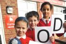 Foley Park Primary School pupils Morgan Puplett, Millie Farnsworth, Sam Stone and Jada Powell celebrate the Good rating from Ofsted