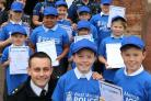 West Mercia Police Inspector Gareth Lougher with Wolverley Sebright cadets Logan Manning, seven, and Archie Butterfield, 10, with fellow police cadets and PC Derya Mustafa, PCSO Nicky Merson and PCSO Kate Easthope