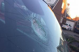 Family covered in glass after boys throw rock at car windscreen