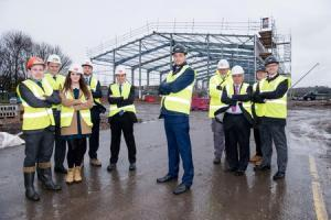 Andrew Preston, of LCP, centre, joined by staff from Bulleys, LSH, LCP, and Black Country LEP, outside the company's new multi-million pound Prime Point development in Kingswinford. Photo: LCP