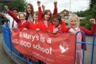 Head teacher Sarah Perrett celebrates with pupils from St Mary's CE Primary