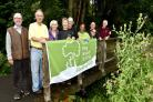 Members of the Friends of Broadwaters Park group celebrate their Green Flag award. Photo by Colin Hill