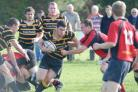 A KCs player tries to crash through Berkswell's defence.
