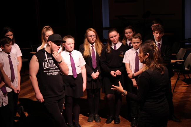 Actress and director Lucy Key putting the School of Rock cast through their paces