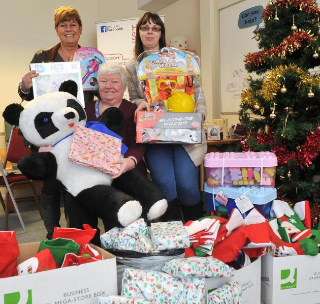 Home-Start staff Donna Scriven, Lynda Williams & Joanne Shinton, with readers' donations for the Shuttle Christmas Gift Appeal