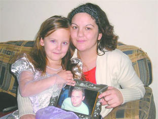 Inspiring others: Donna Davidson and daughter Leonie-Olivia, 6, holding a photograph of James Ridewood, Donna's late brother.