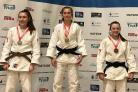 Leah Grosvenor (second from left) collecting he gold medal. Picture from Samurai Judo Club