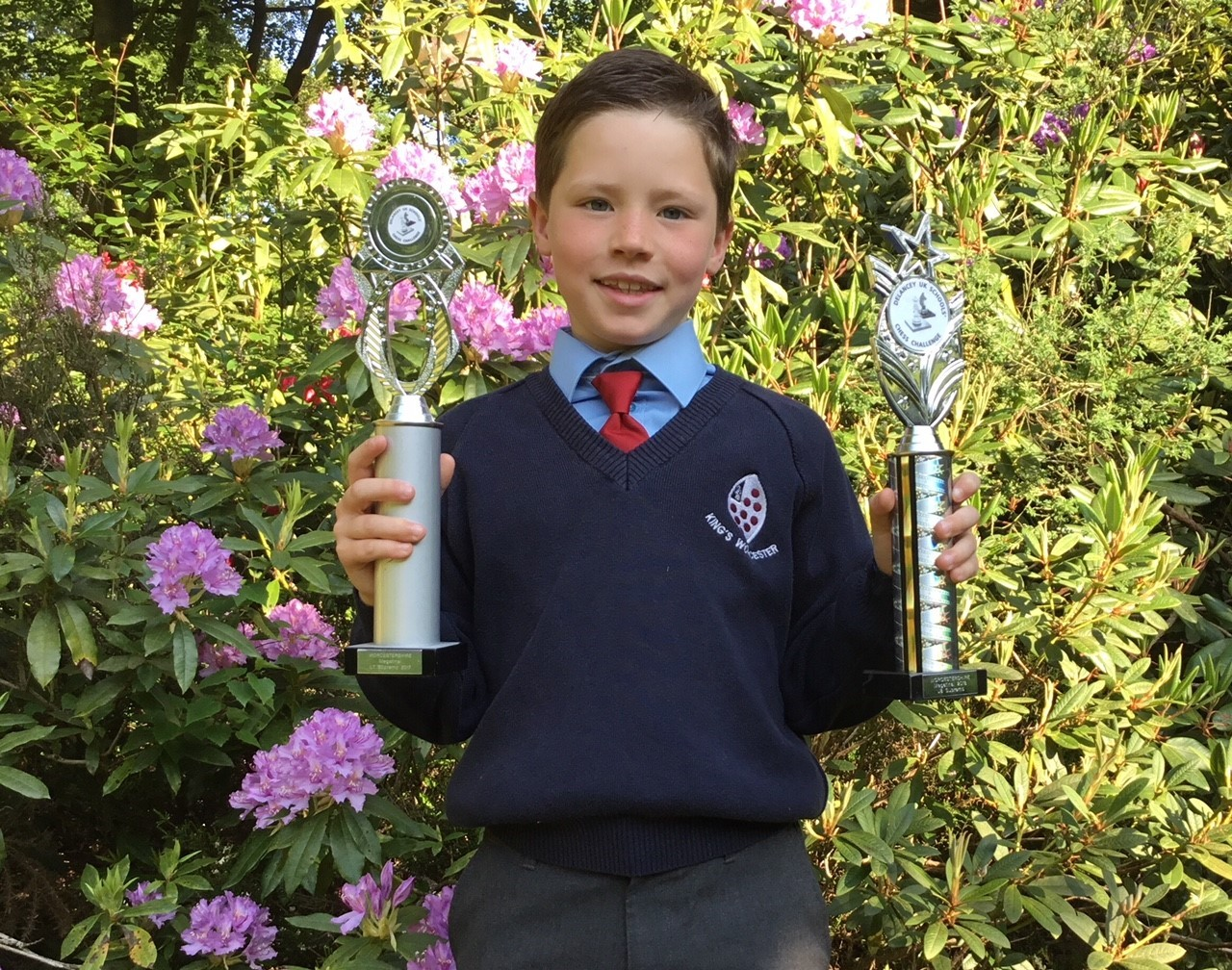 Young chess star Cameron Henry celebrates his success