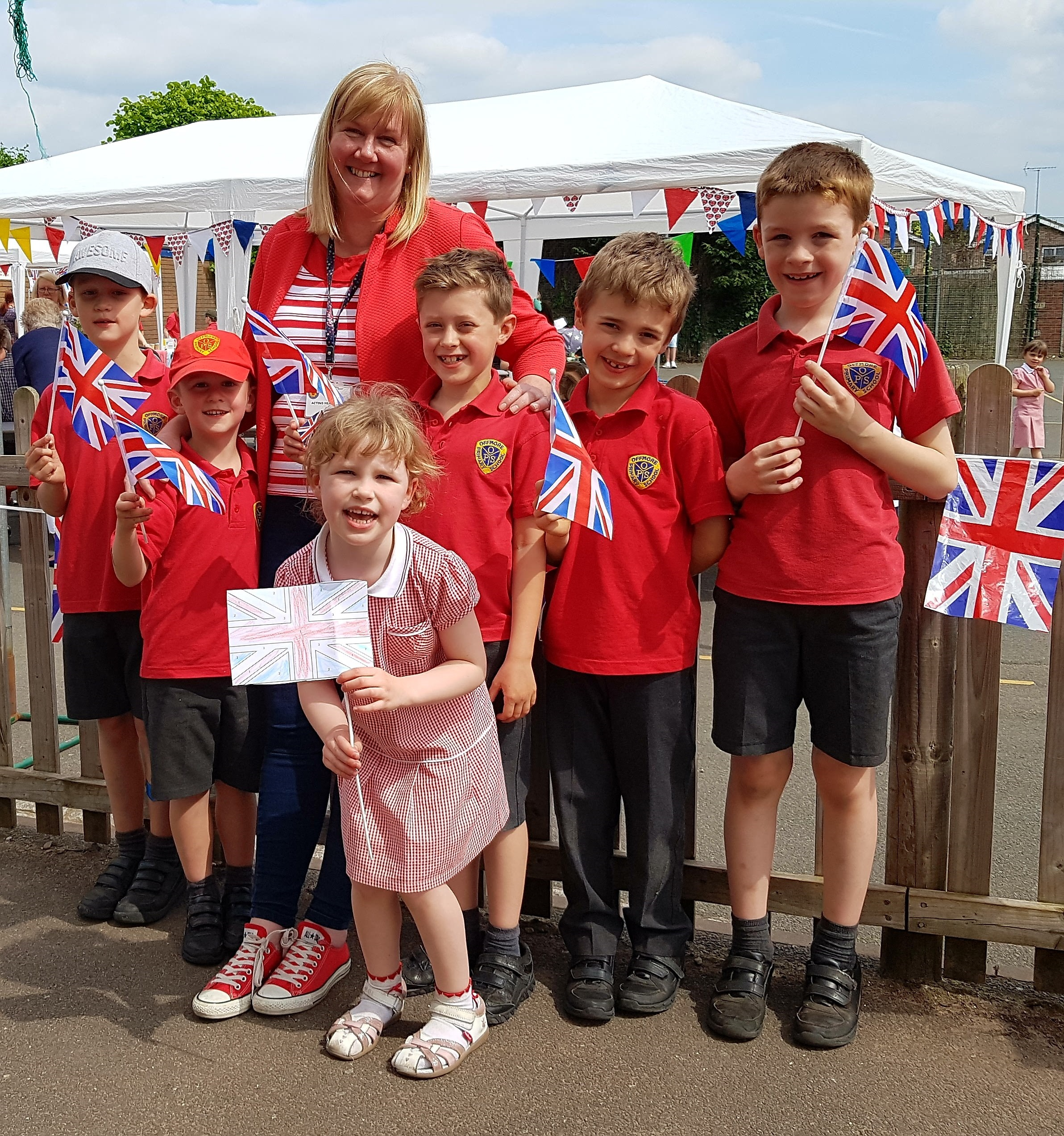 Head teacher Tabitha Smith with pupils from Offmore Primary School celebrate the royal wedding