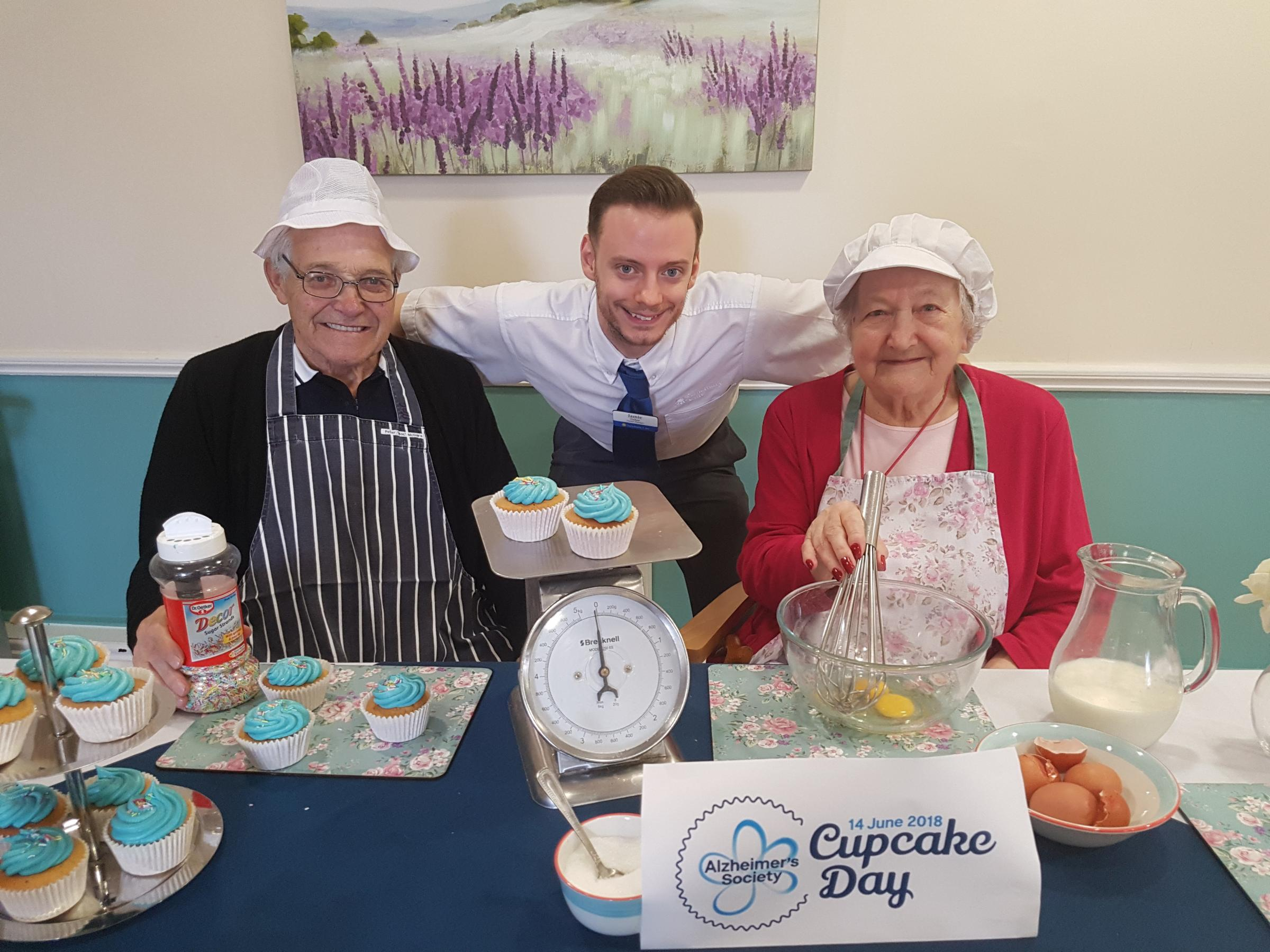 Deputy Manager Jamie Fisher (Centre) with residents David Andrews and Iris Hamblin