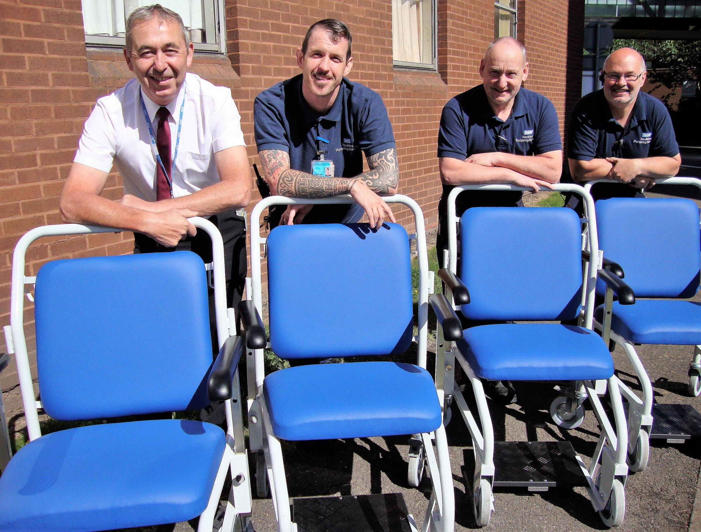 Portering supervisor Neville Cartwright, Chris George, Keith Palmer and Karl Morgan with the new wheelchairs