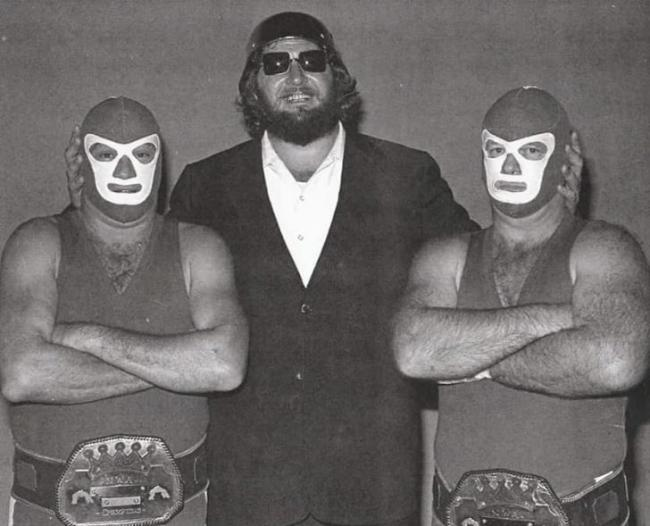 Can-Am Confusion tag team with their West Coast tag team belts and manager Sir Oliver