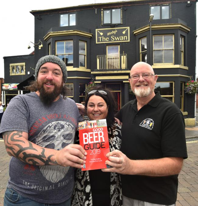 Matt Worley and Maria Plant of The Swan with CAMRA's Nick Yarwood. PIC: Colin Hill