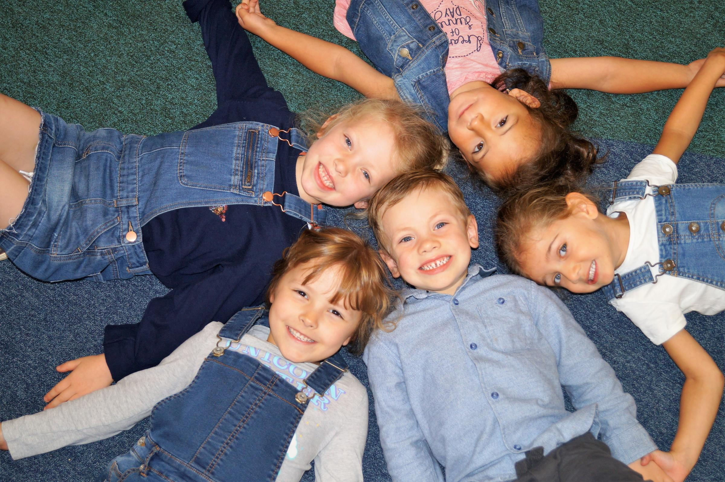 Little Trinity Nursery children, 3 years-old Sophia Tanase, Sienna Atwal and Harry Billingsley and Holy Trinity School pupils, 6 year-old Florence Hill and Sophie Billingsley, dressed to impress on Jeans for Genes Day.