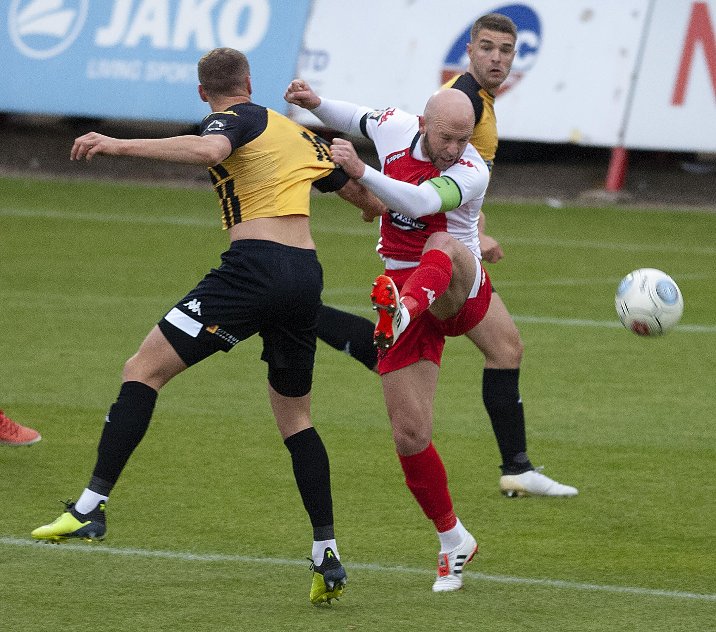Kidderminster's Jimmy O'Connor challenges Southport's Brad Bauress. Photo by Paul France.