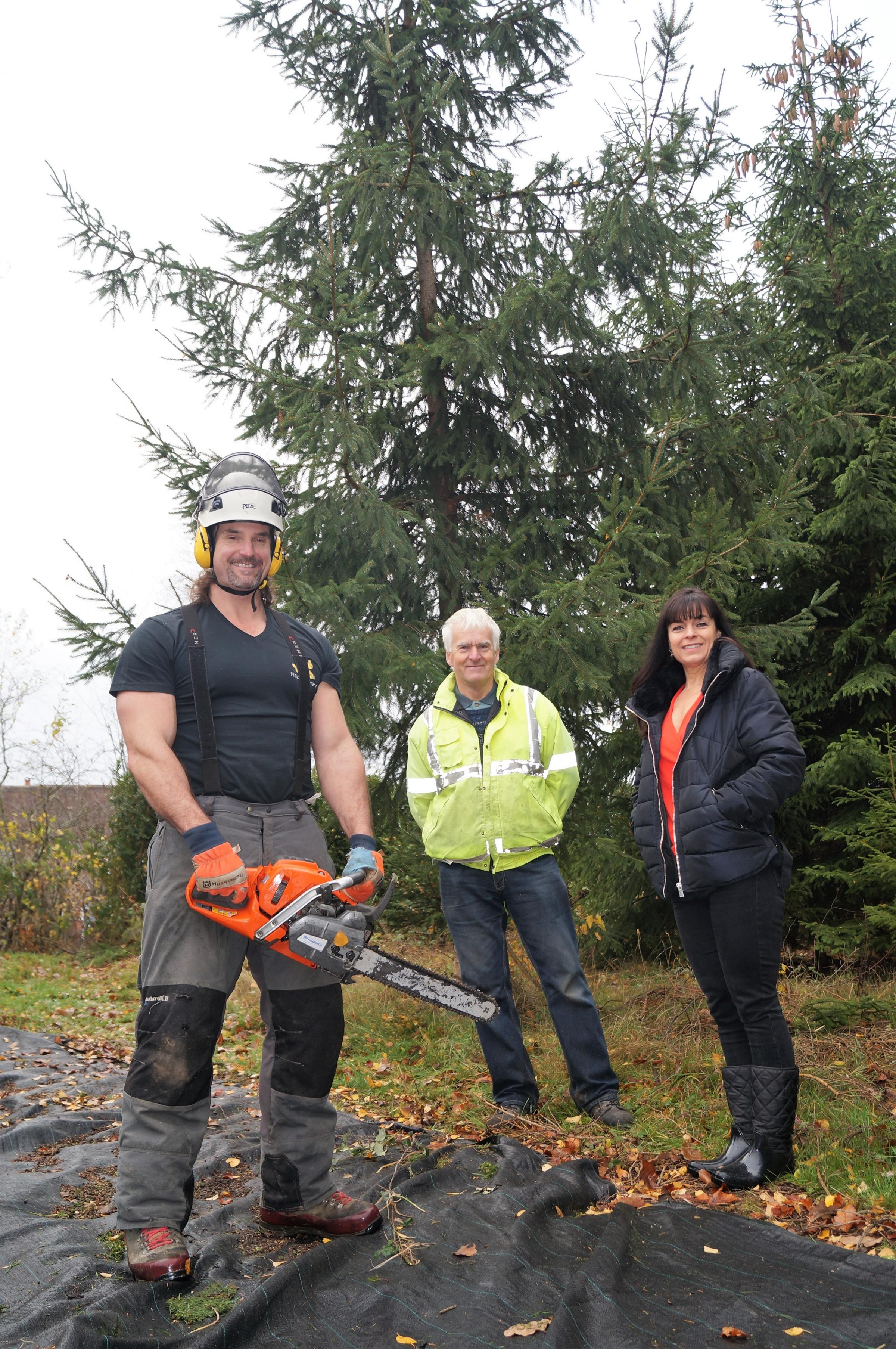 Tree surgeon John Russell, of Happy Banana Tree Services, Bill White, and Holy Trinity School PTA chair Michella Howles