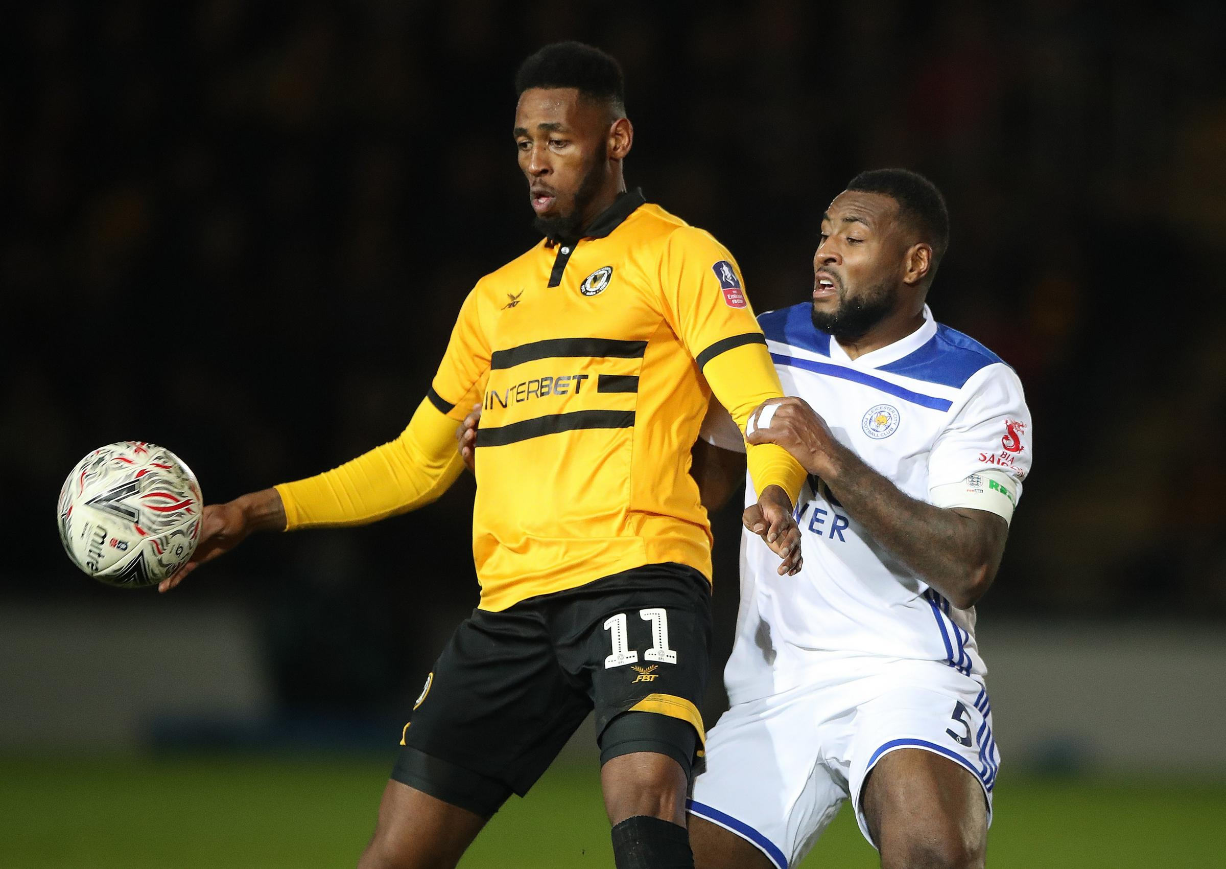 Newport County's Jamille Matt (left) and Leicester City's Wes Morgan in the previous round. Photo: PA Images.