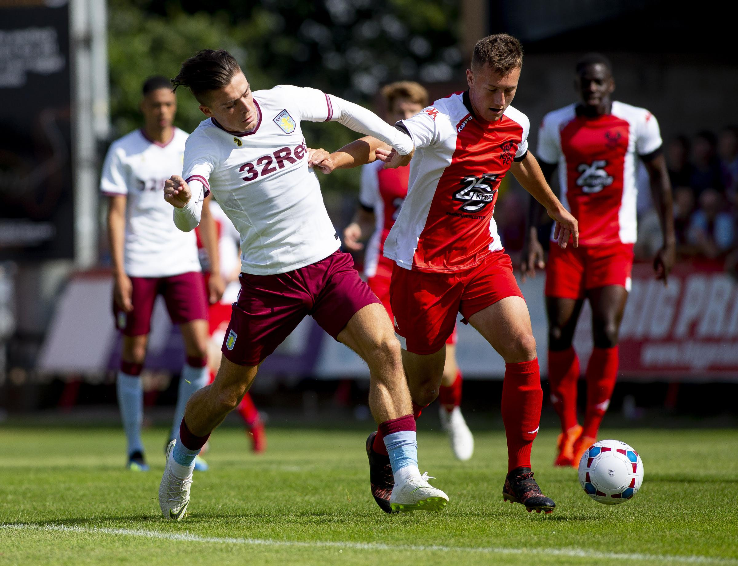 Harry Higginson, in action against Villa's Jack Grealish during pre-season. Pic: AVFC.